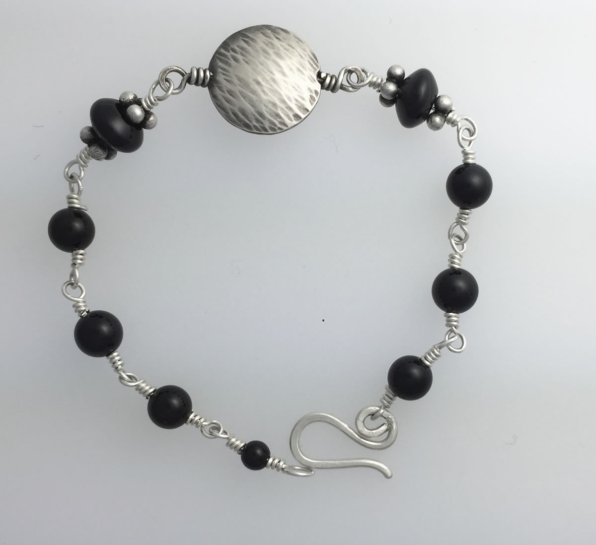 CA0043 Silver handmade bracelet small wrapped onyx metal double domed Kathleen Barris Jewelry