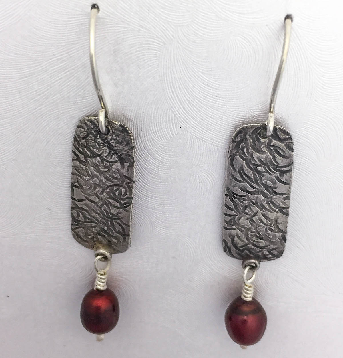 handmade earrings argentium silver hammered texture with deep burgundy pearls